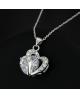 Krásný pozlacený přívěsek ve tvaru dvojitého srdce se zirkony